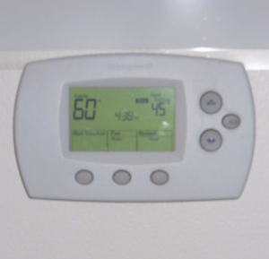 Digital thermostat set at 60 degrees.