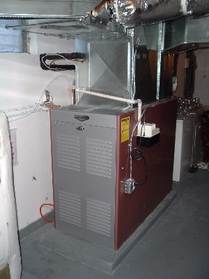 Energy-efficient furnace installed in basement area.